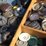 Reema's close up photo of buttons for sale at a street market in Copenhagen - © ReemaFaris.com