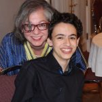 Reema, with her son Luc at a community fundraiser - ReemaFaris.com