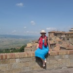 Reema, enjoying the panoramic view from the Etruscan Walls of Volterra - ReemaFaris.com