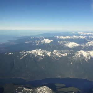 Reema captures the Lower Mainland mountains from an airplane window - © ReemaFaris.com
