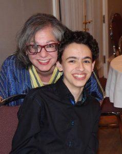 Reema, with her son Luc at a community fundraiser - ReemaFaris.com