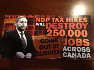Reema scans in the side of the direct mail piece attacking the federal NDP.