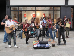 Reema shares an image of the Galway Street Club sharing their music on the streets of Dublin.